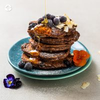 Sugar free protein pancakes using banana and Wazoogles Superfoods Chocolate Moondust, with added coconut and blueberries; these go down well anytime of day.