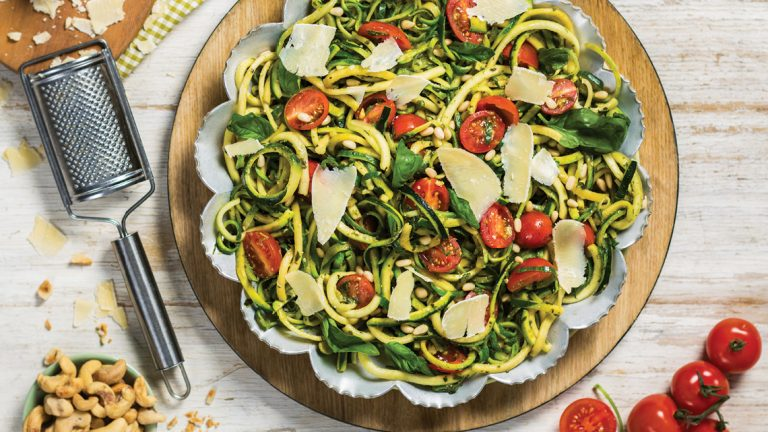 ZUCCHINI NOODLES TOSSED IN A FRESH BASIL AND CASHEW NUT PESTO