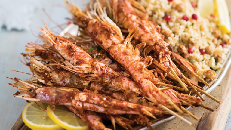 GRILLED HARISSA PRAWNS ON A BED OF SPICY CHICKPEA-AND-POMEGRANATE COUSCOUS
